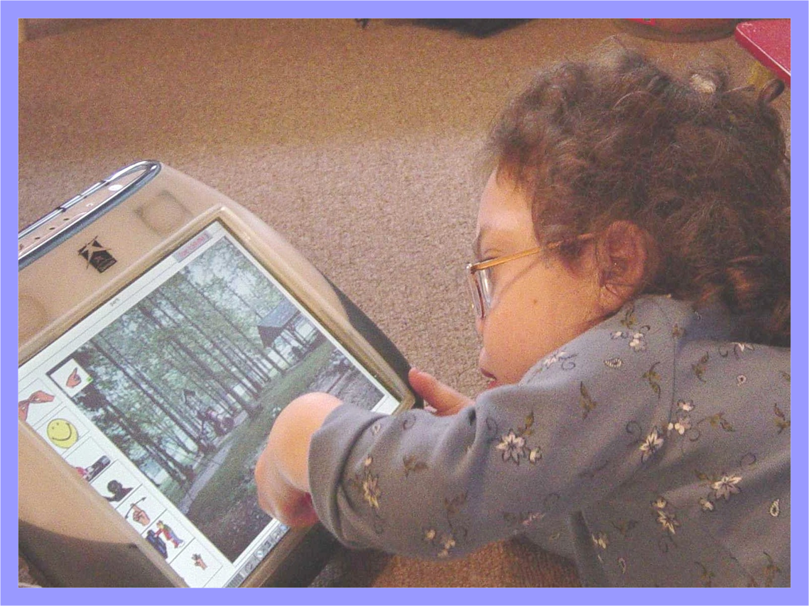 Easy-to-use AAC, child accessing touch screen