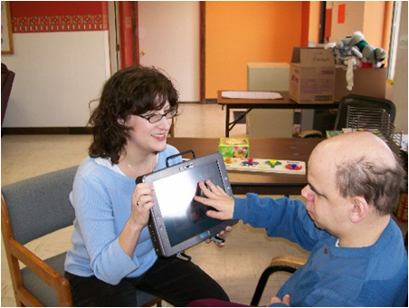 Older communicators:  JF and Kathy use AAC to share a conversation.